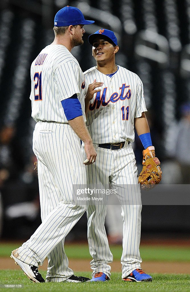 Ruben Tejada #11 of the New York Mets talks with his teammate Lucas Duda #21 after game two of a doubleheader against the Miami Marlin on September 14, 2013 at Citi Field in the Flushing neighborhood of the Queens borough of New York City. The Mets defeated the Marlins 3-1.