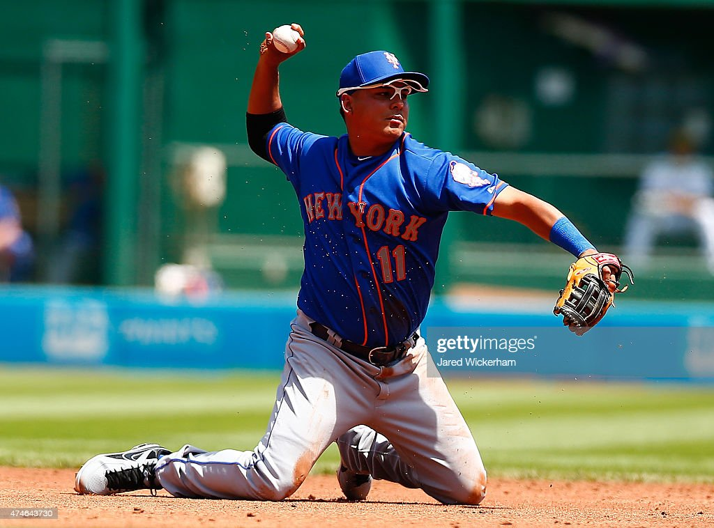 Ruben Tejada #11 of the New York Mets throws from his knees in the fourth inning against the Pittsburgh Pirates during the game at PNC Park on May 24, 2015 in Pittsburgh, Pennsylvania.