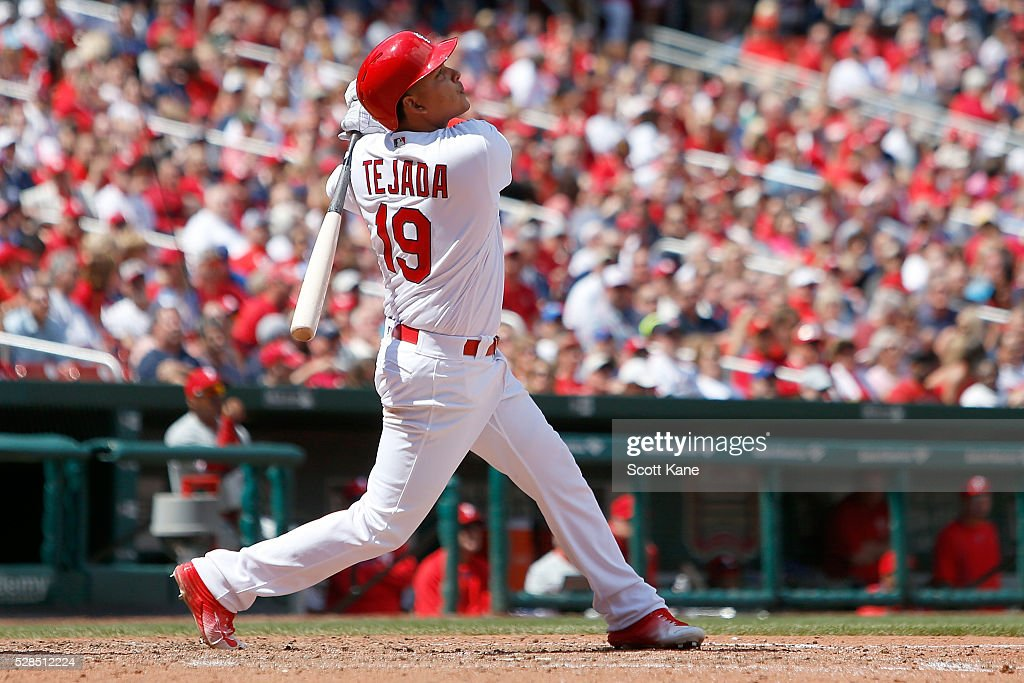 Ruben Tejada #19 of the St. Louis Cardinals hits a sacrafice fly during the seventh inning against the Philadelphia Phillies at Busch Stadium on May 5, 2016 in St. Louis, Missouri.