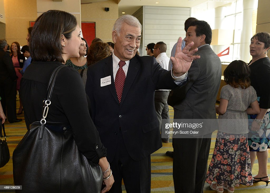 Ruben Valdez, center, the winner of The Ronald E. Montoya Lifetime Achievement Award, greets attendees before the luncheon. The Hispanic Chamber of Commerce of Metro Denver hosts its 28th Annual Business Awards Luncheon at the Hyatt Regency in downtown Denver on May 9, 2014.