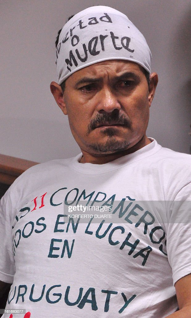 Ruben Villalba, one of the 14 farmers tried for the June 15, 2012 slaughter of Curuguaty, where 11 farmers and 6 policemen were killed, appears in court in Coronel Oviedo, Paraguay, on February 14, 2013. The hearing was postponed after the defence of the accused challenged judge Jose Benitez.
