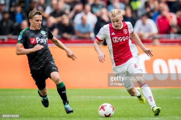 Ruben Yttergard Jenssen of FC Groningen Donny van de Beek of Ajax during the Dutch Eredivisie match between Ajax Amsterdam and FC Groningen at the...