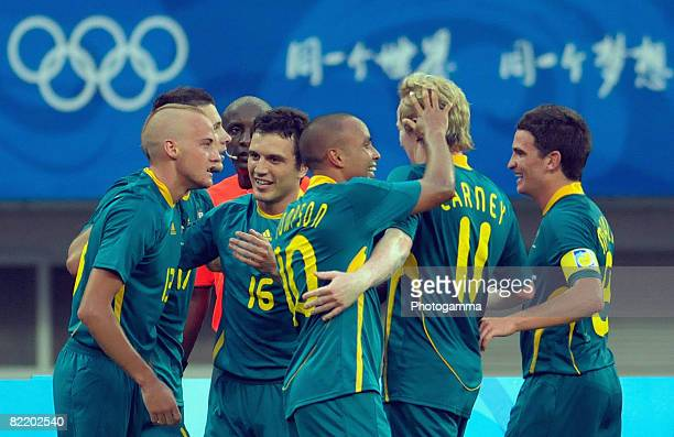 Ruben Zadkovich of Australia is congratulated by teammates after scoring during Men's Group A match between Australia and Serbia on Day 1 of the...