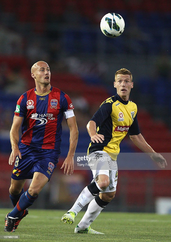 Ruben Zadkovich of the Jets and Oliver Bolzanic of the Mariners keep their eye on the ball during the round ten A-League match between the Newcastle Jets and the Central Coast Mariners at Hunter Stadium on December 8, 2012 in Newcastle, Australia.