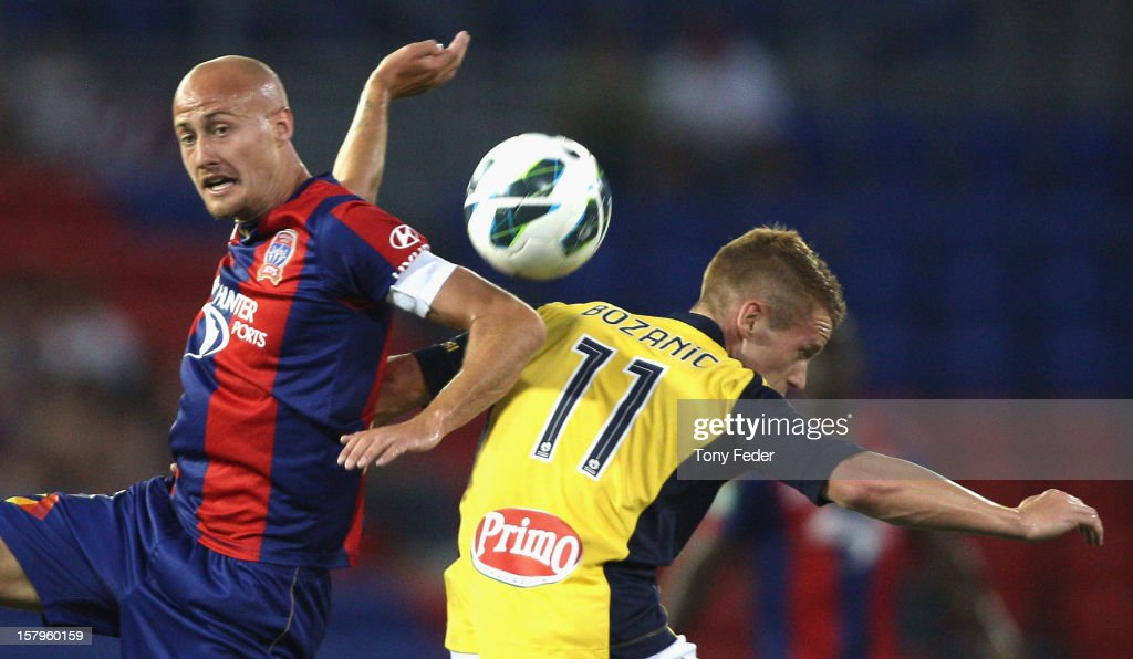 Ruben Zadkovich of the Jets and Oliver Bozanic of the Mariners contest the ball during the round ten A-League match between the Newcastle Jets and the Central Coast Mariners at Hunter Stadium on December 8, 2012 in Newcastle, Australia.