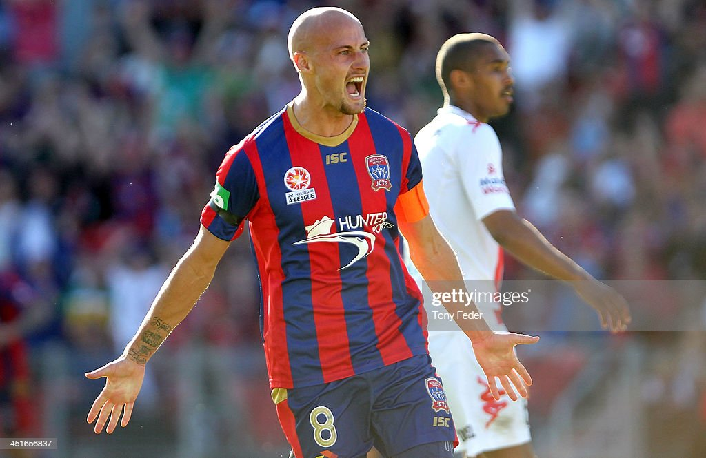 <a gi-track='captionPersonalityLinkClicked' href=/galleries/search?phrase=Ruben+Zadkovich&family=editorial&specificpeople=791211 ng-click='$event.stopPropagation()'>Ruben Zadkovich</a> of the Jets celebrates a a team mates goal during the round seven A-League match between the Newcastle Jets and the Melbourne Heart at Hunter Stadium on November 24, 2013 in Newcastle, Australia.