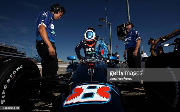 Rubens Barichello of Brazil climbs aboard his BCM/Embrase KV Racing Chevrolet Dallara during practice for the IZOD INDYCAR Series Iowa Corn Indy 250...