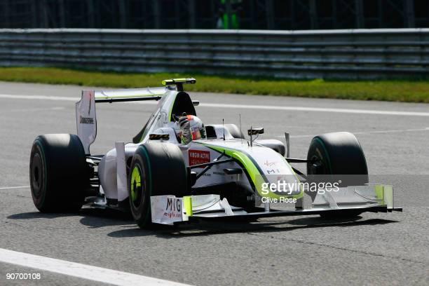 Rubens Barrichello of Brazil and Brawn GP celebrates as he crosses the finish line to win the Italian Formula One Grand Prix at the Autodromo...