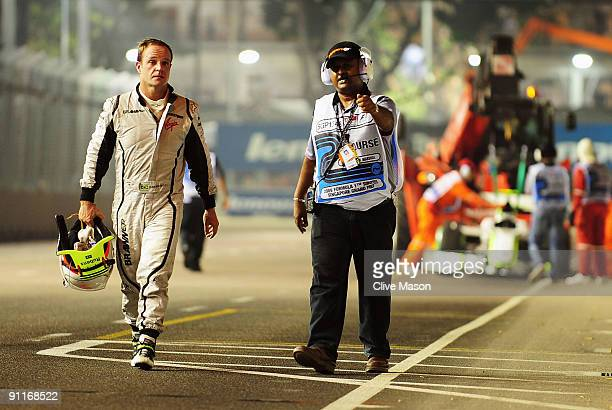 Rubens Barrichello of Brazil and Brawn GP crashes and causes the session to be red flagged during qualifying for the Singapore Formula One Grand Prix...
