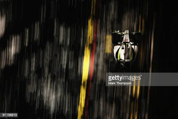 Rubens Barrichello of Brazil and Brawn GP drives during practice for the Singapore Formula One Grand Prix at the Marina Bay Street Circuit on...