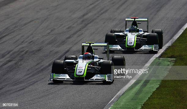 Rubens Barrichello of Brazil and Brawn GP leads from team mate Jenson Button of Great Britain and Brawn GP on his way to winning the Italian Formula...