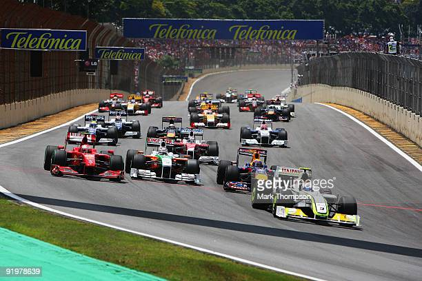 Rubens Barrichello of Brazil and Brawn GP leads the field at the start of the Brazilian Formula One Grand Prix at the Interlagos Circuit on October...