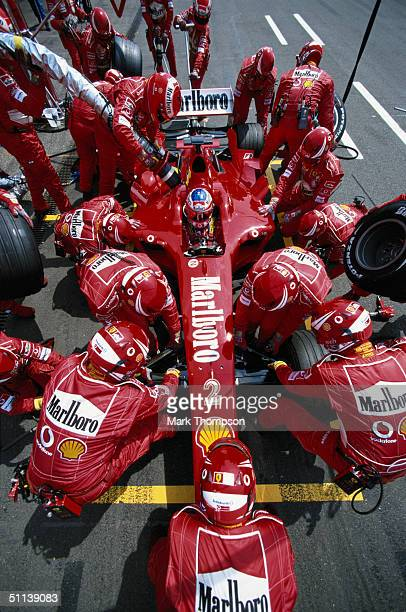 Rubens Barrichello of Brazil and the Ferrari team in pit stop action during the German F1 Grand Prix at the Hockenheim Circuit on July 25 in...