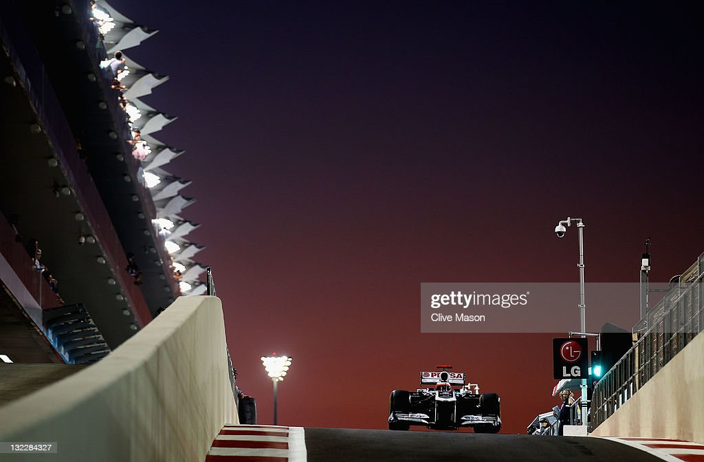 xABU DHABI, UNITED ARAB EMIRATES - NOVEMBER 11: Rubens Barrichello of Brazil and Williams drives down the pitlane during practice for the Abu Dhabi Formula One Grand Prix at the Yas Marina Circuit on November 11, 2011 in Abu Dhabi, United Arab Emirates.