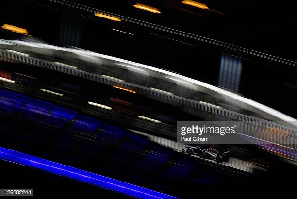 Rubens Barrichello of Brazil and Williams drives during practice for the Singapore Formula One Grand Prix at the Marina Bay Street Circuit on...
