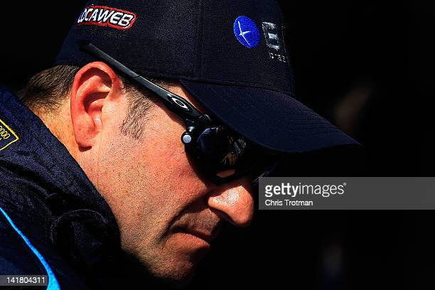 Rubens Barrichello of Brazil driver of the BMC/Embrase KV Racing Technology Chevrolets sit in the pits following practice for the IZOD IndyCar Series...
