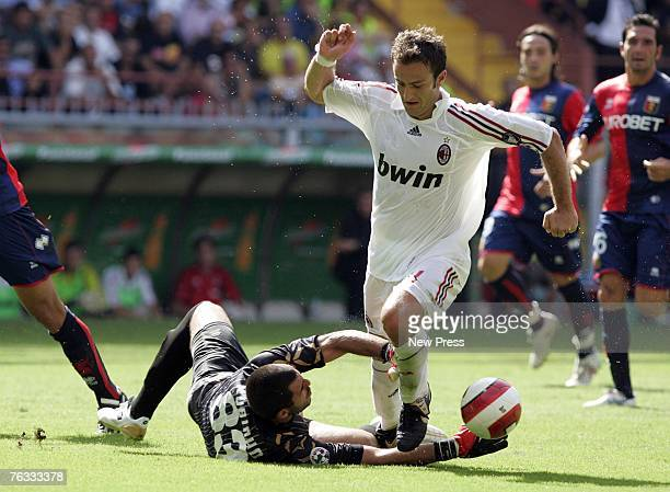 Rubens Fernando Rubinho of Genoa in action against Alberto Gilardino of AC Milan during the Serie A match between Genoa and AC Milan at the Stadio...