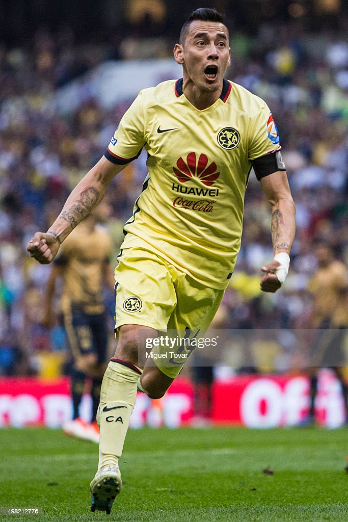 Rubens Sambueza of America celebrates after scoring the first goal of his team during the 17th round match between America and Pumas UNAM as part of the Apertura 2015 Liga MX at Azteca Stadium on November 21, 2015 in Mexico City, Mexico.