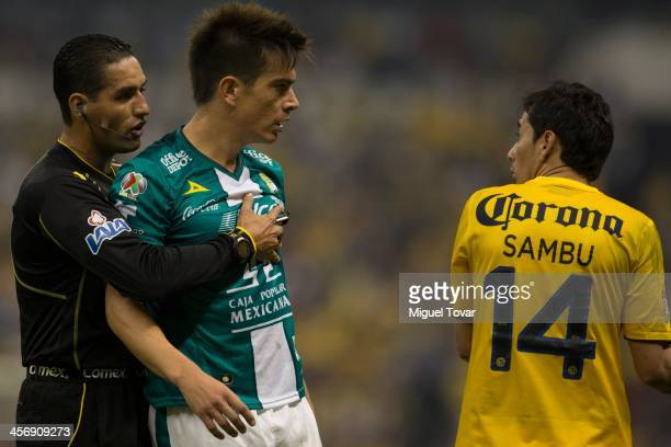 Rubens Sambueza of America discusses with Ignacio Gonzalez of Leon during the leg 2 of a Championship match between America and Leon as part of the...