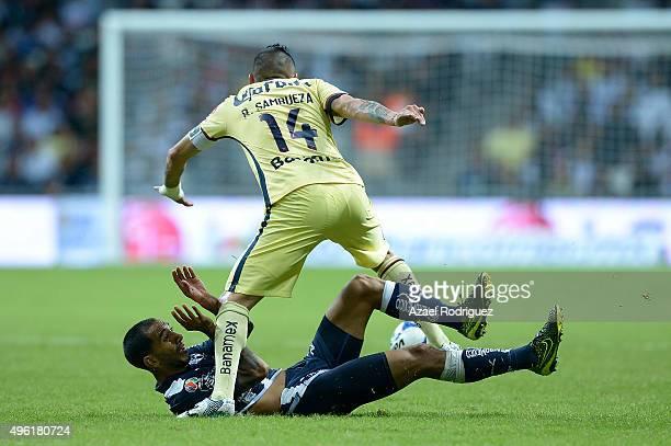 Rubens Sambueza of America runs over Edgar Castillo of Monterrey during the 16th round match between Monterrey and America as part of the Apertura...