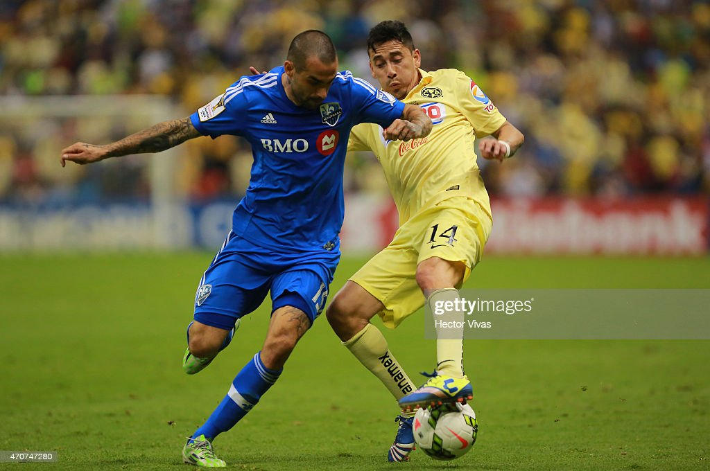 Rubens Sambueza of America struggles for the ball with Andres Romero of Montreal Impact during a Championship first leg match between America and...