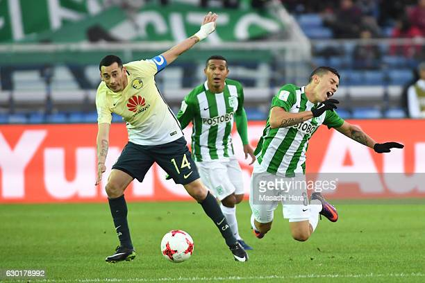 Rubens Sambueza of Club America and Mateus Uribe of Atletico National compete for the ball during the FIFA Club World Cup 3rd place match between...