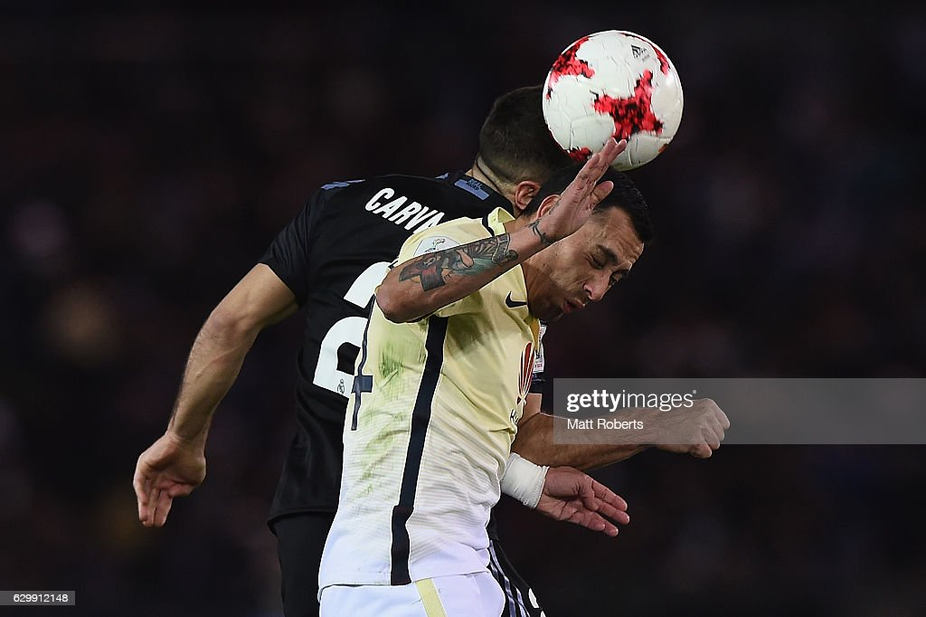 Rubens Sambueza of Club America competes for the ball against Daniel Carvajal of Real Madrid during the FIFA Club World Cup Japan semi-final match between Club America v Real Madrid at International Stadium Yokohama on December 15, 2016 in Yokohama, Japan.
