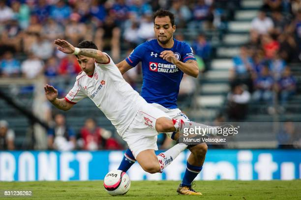 Rubens Sambueza of Toluca struggles for the ball with Adrian Aldrete of Cruz Azul during the 4th round match between Cruz Azul and Chivas as part of...