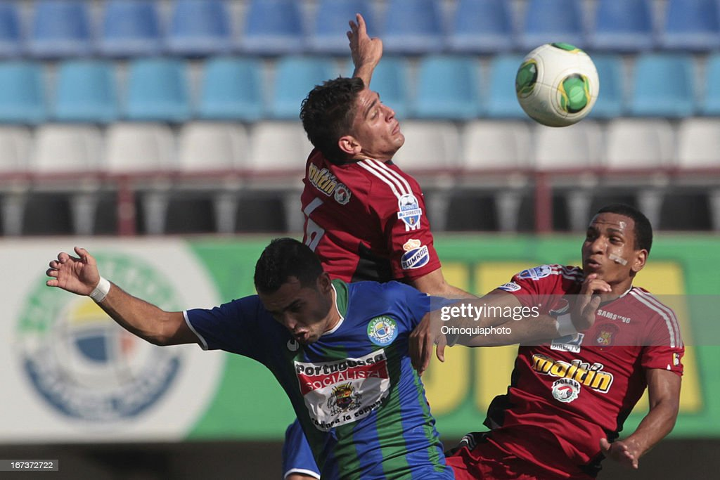Rubert Quijada and Romulo Otero of Caracas FC fight for the ball during a match between Llaneros de Guanare and Caracas FC as part of the Clausura Tournament 2013 at the Estadio Olimpico Rafael Calles Pinto on April 24, 2013 in Guanare, Venezuela.