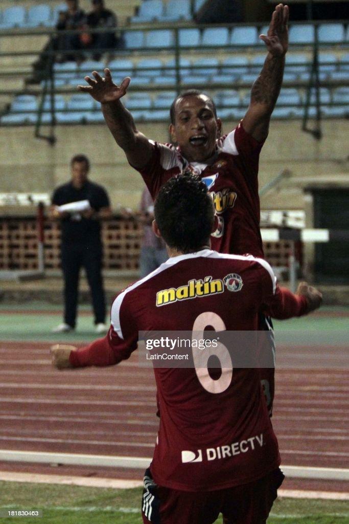 Rubert Quijada of Caracas FC celebrates a goal against Deportivo La Guaira during a match between Caracas FC and Deportivo La Guaira as part of the Apertura 2013 at Brígido Iriarte Stadium on September 25, 2013 in Caracas, Venezuela.