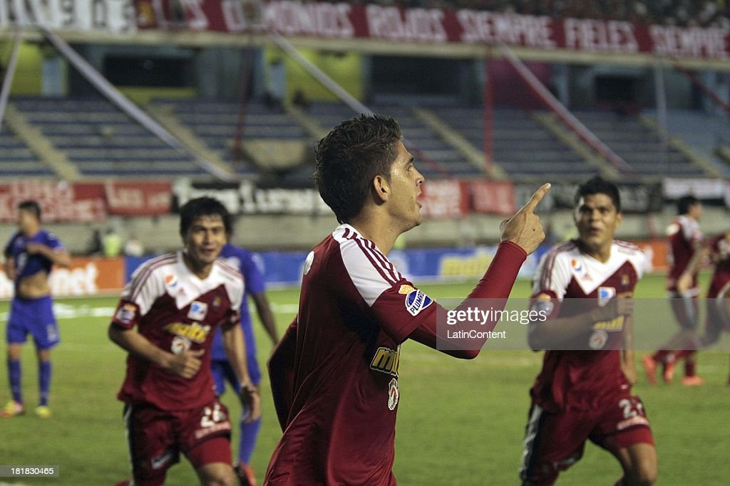Rubert Quijada of Caracas FC celebrates a goal against Deportivo La Guaira during a match between Caracas FC and Deportivo La Guaira as part of the Apertura 2013 at Brígido Iriarte Stadium on September 25, 2013 in Caracas, Venezuela.