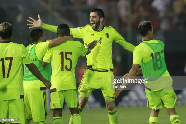 Rubert Quijada of Venezuela celebrates with teammates after Yangel Herrera of Venezuela scored the first goal of his team during a match between...