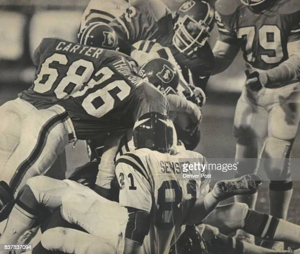 Rubin Carter and Billy Thompson get in on the kill against Minnesota's Ted Brown Monday night after Randy Gradishar made initial hit Credit Denver...