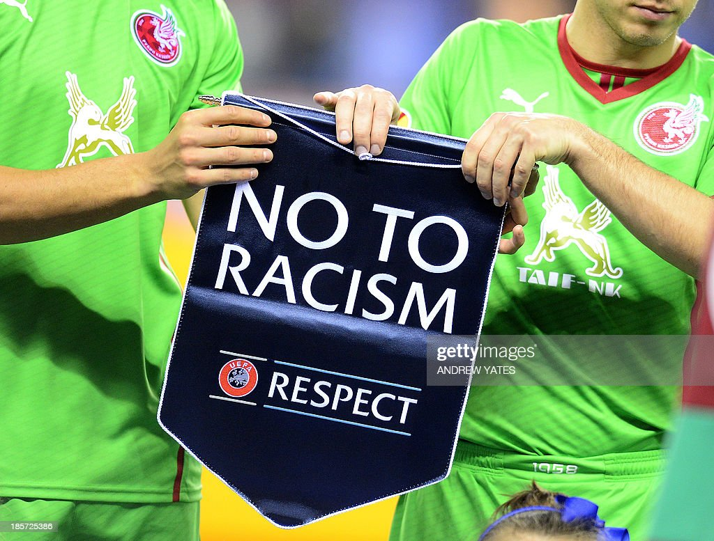 Rubin Kazan players hold an anti racism pendant before the UEFA Europa League Group D football match between Wigan Athletic and Rubin Kazan at the DW...
