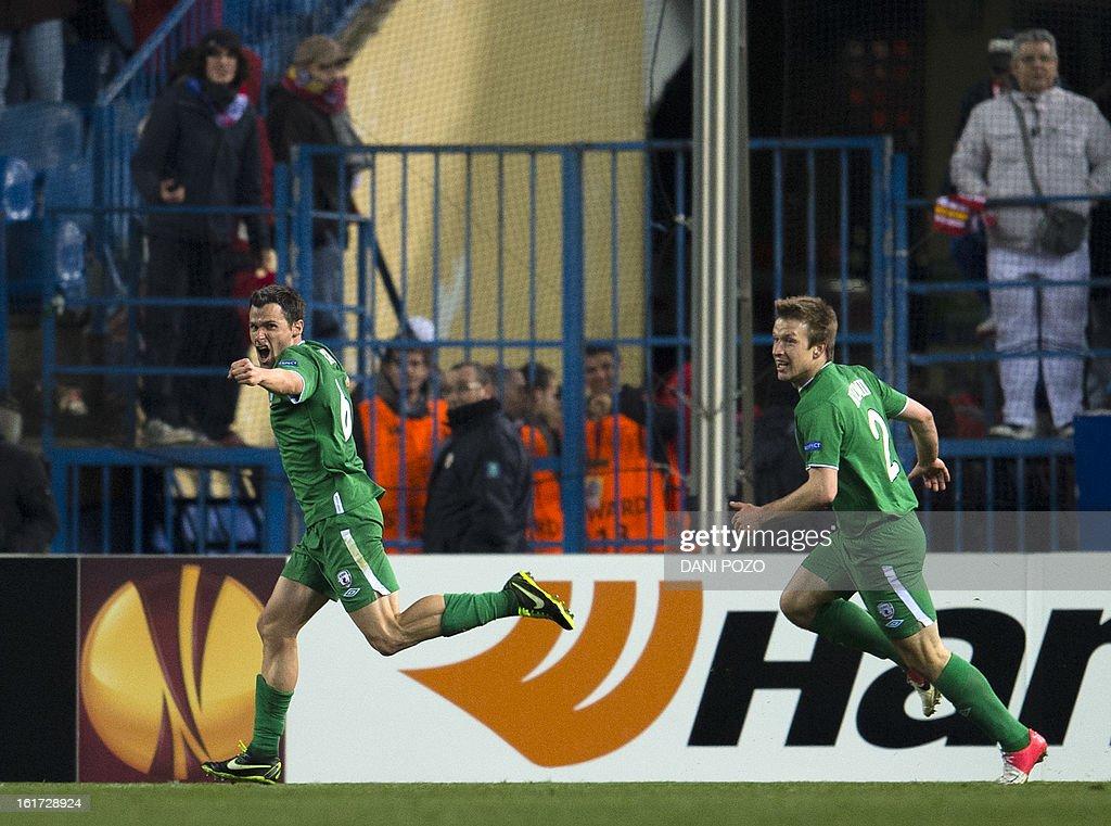 Rubin Kazan's Spanish midfielder Pablo Orbaiz (L) celebrates after scoring during the UEFA Europa league round of 32 first leg football match Atletico de Madrid vs FC Rubin Kazan at the Vicente Calderon stadium in Madrid on February 14, 2013.