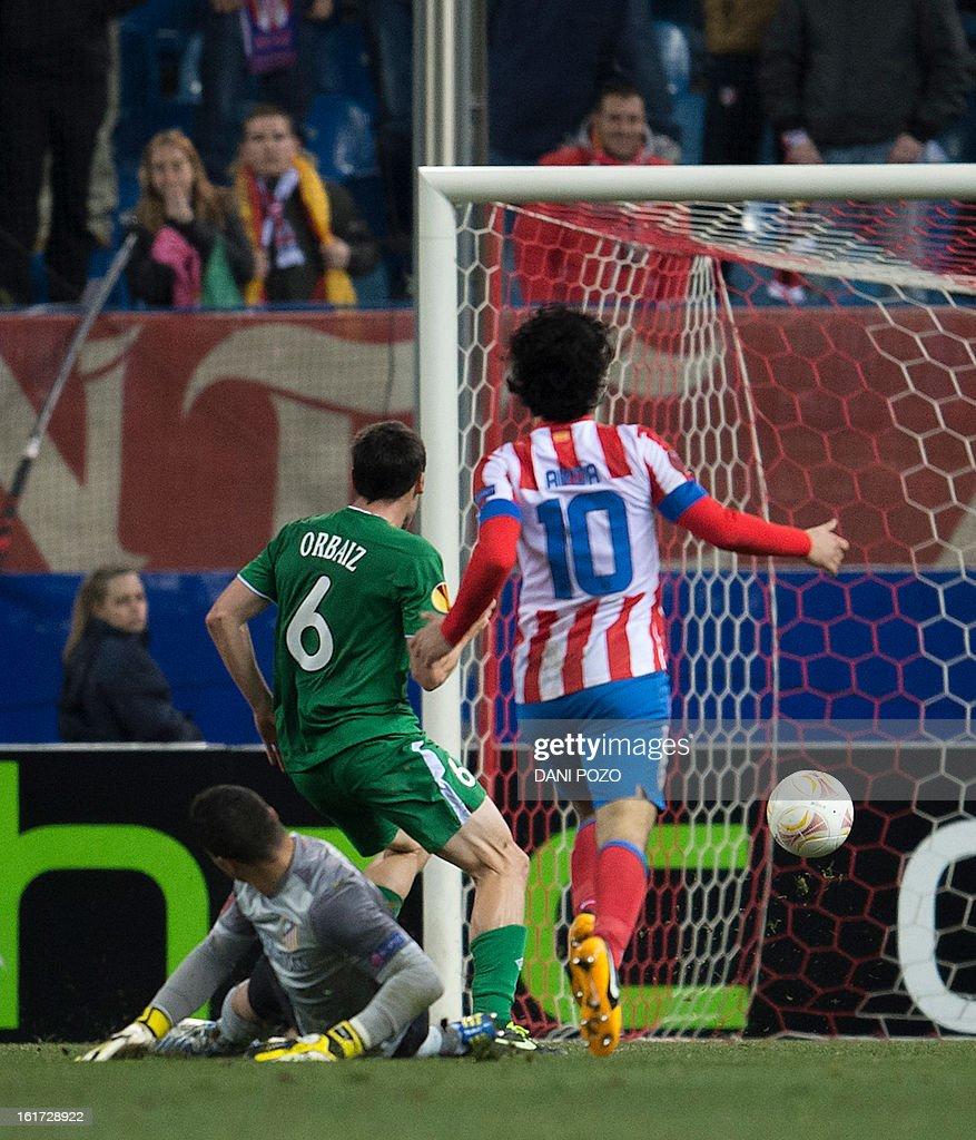 Rubin Kazan's Spanish midfielder Pablo Orbaiz (C) scores during the UEFA Europa league round of 32 first leg football match Atletico de Madrid vs FC Rubin Kazan at the Vicente Calderon stadium in Madrid on February 14, 2013. Rubin Kazan won 2-0.