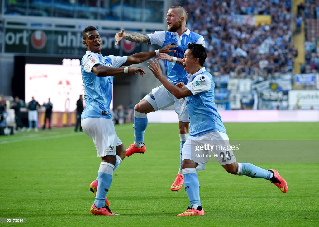 Rubin Okotie of 1860 Muenchen celebrates with his teammates after scoring his team's first goal during the Second Bundesliga match between 1 FC...