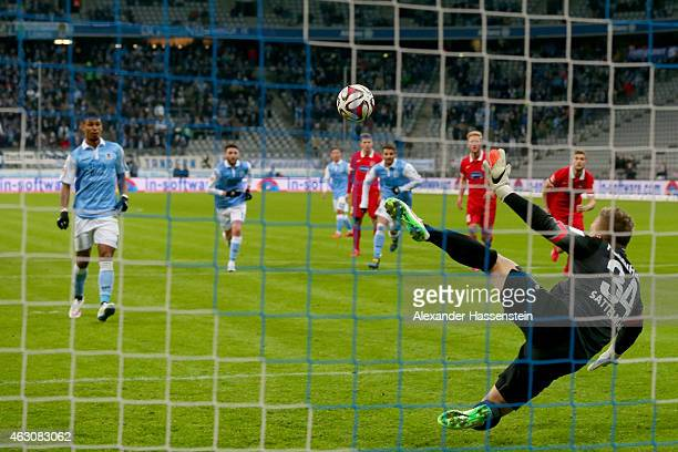 Rubin Okotie of 1860 Muenchen scores the opening goal with a penalty against Rouven Sattelmaier keeper of Heidenheim during the Second Bundesliga...
