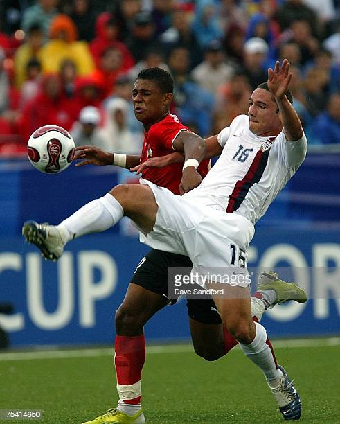 Rubin Okotie of Team Austria battles for the ball with Julian Valentin of Team USA during their FIFA U20 World Cup Canada 2007 quarterfinal game at...