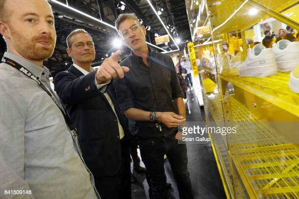 Rubin Ritter shows around Governing Mayor of Berlin Michael Mueller with VP of Marketing Zalando Carsten Hendrich during the opening of Bread Butter...