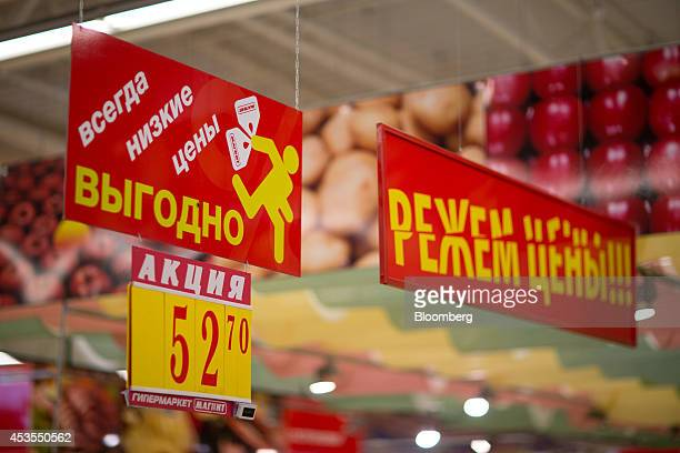 A ruble price sign sits above produce for sale in the fruit and vegetable section of an OAO Magnit hypermarket in Krasnodar Russia on Thursday Aug 7...