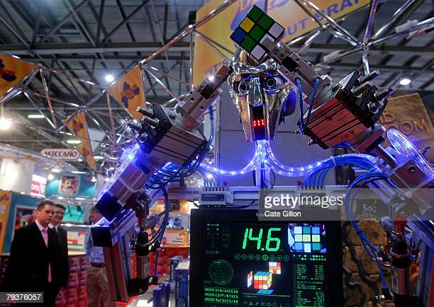 Rubot 2 nicknamed the 'Cubinator' and invented by Peter Redmond works out the Rubiks cube as businessmen watch on January 30 2008 in London The Toy...
