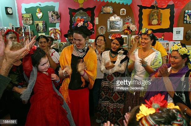 Ruby Alford and her mother Mary Rafferty acknowledge the crowd's applause as they win first place in the Frida Kahlo lookalike contest at the In...
