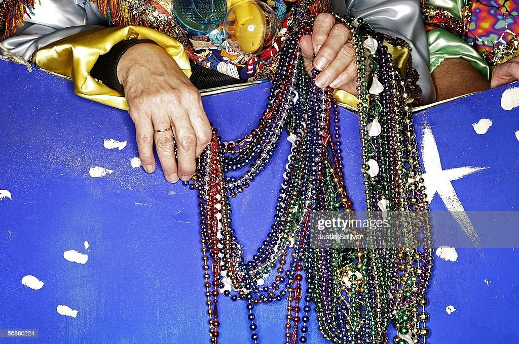 Ruby Gallagos holds a handful of beads before the start of the Excalibur Mardi Gras parade February 17 2006 in Metairie Louisiana The Mardi Gras...