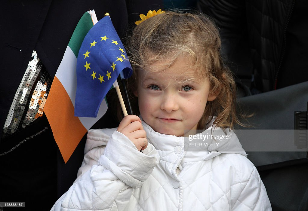 Ruby Nealon, 4 years old, listens to the Irish Prime Minister speak during a flag-raising ceremony at Dublin Castle in Dublin, Ireland on December 31, 2012 ahead of Ireland's assumption of the rotating presidency of the European Union on Jauary 1, 2013.