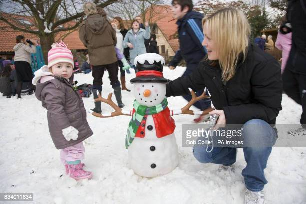 Ruby Simpson two and her mother Michelle from St Martins Hospice in Weatherby Leeds enjoy the snow at Martin House children's hospice after local...