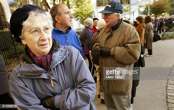 Ruby Vogelfanger 69yearsold stands with soontobe flu vaccine recipients as they wait in line outside the District Health Center October 22 2004 in...