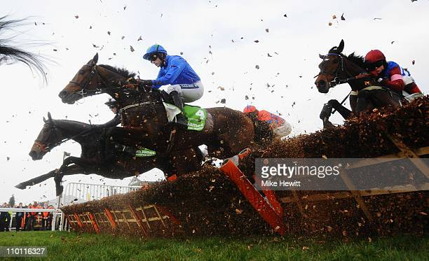 Ruby Walsh and Hurricane Fly jump the last on the first circuit on their way to victory in the Stan James Champion Hurdle Challenge Trophy at...