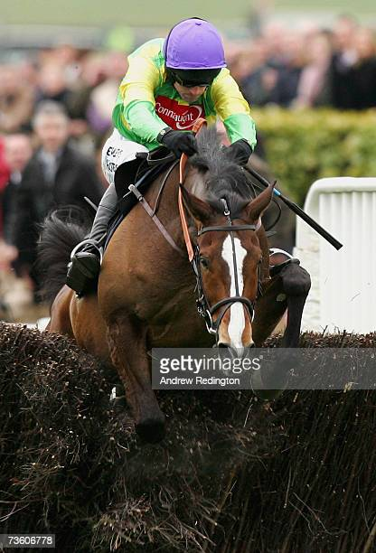 Ruby Walsh and Kauto Star clear the final fence on their way to victory in The totesport Cheltenham Gold Cup Steeple Chase on the final day of The...