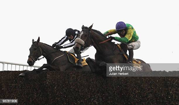 Ruby Walsh and Kauto Star clear the last fence in company with the Paddy Brennan ridden Imperial Commander before wining The Betfair Steeple Chase...